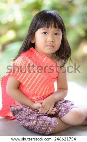 Cute Thai girl wearing typical Thai dress, identity culture of Thailand - stock photo