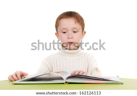 cute thoughtful boy reading a book