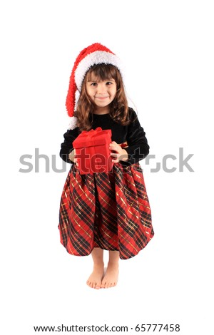 Cute three year old little girl dressed up in a fancy dress and christmas hat holding a red giftbox standing barefoot on a white background - stock photo