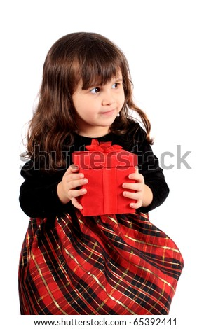 Cute three year old little girl dressed up in a fancy dress  holding a red giftbox on a white background - stock photo