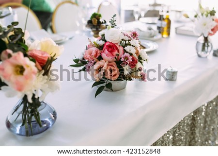 Cute tiny bouquet of flowers on the table - stock photo