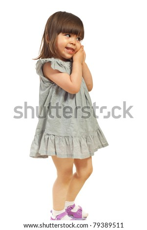Cute toddle girl looking sideways and holding hands on cheek isolated on white background