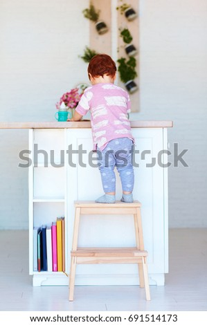 cute toddler baby climbs on step stool trying to reach things on the high desk & Step-stool Stock Images Royalty-Free Images u0026 Vectors | Shutterstock islam-shia.org