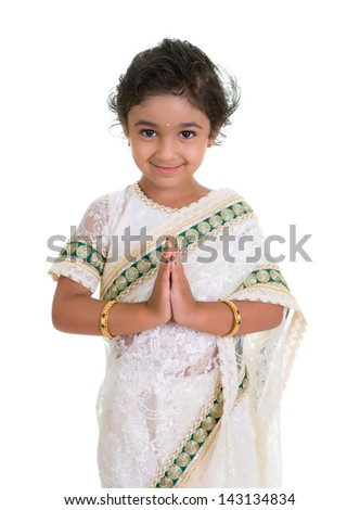 Cute Toddler Dressed in Saree with Folded Hands Representing Traditional Indian Greeting, Namaste, Isolated on White - stock photo