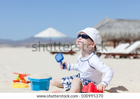 cute toddler enjoying summer vacation at the tropical beach