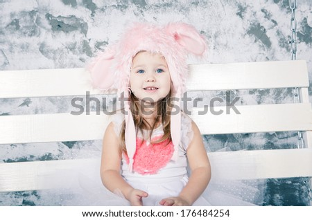 Cute toddler girl with easter bunny fancy ears - stock photo
