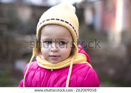 cute toddler in winter clothes and hat - stock photo