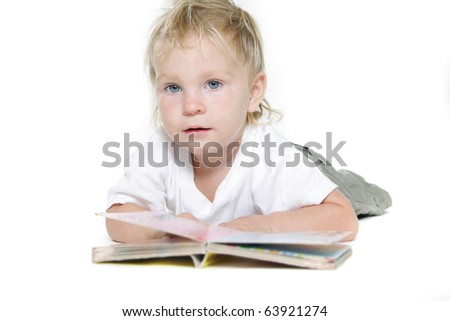 cute toddler reading book over white