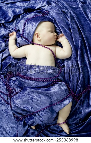 Cute toddler sleeping in bed during the day - stock photo