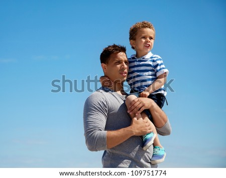 Cute toddler with his dad spending time outdoors