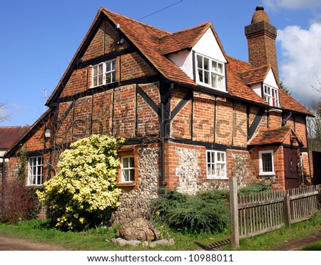 Cute traditional brick and timber cottage in Buckinghamshire England - stock photo