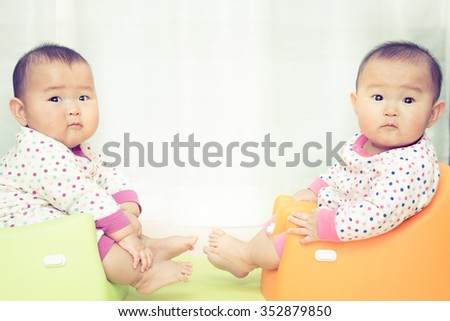 Cute twin baby, Japanese - stock photo