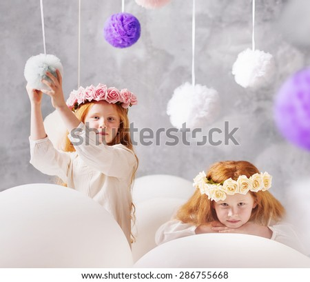 Cute twins sisters - stock photo