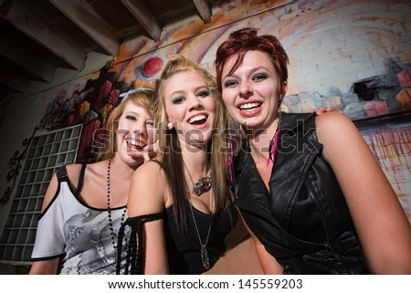 Cute urban teenage girls laughing together