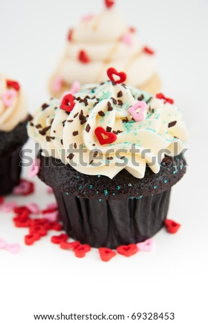 Cute Valentine's Day Chocolate Cupcake with Tiny Hearts and Sprinkles