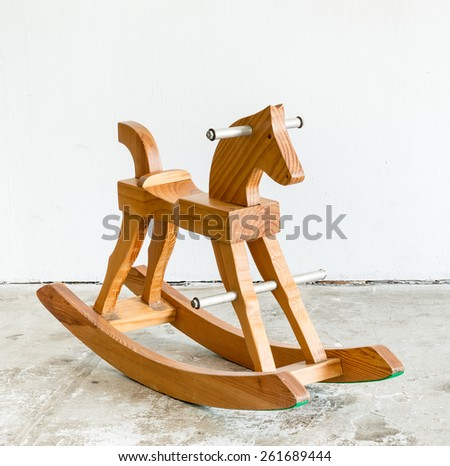 Cute vintage classic rocking horse chair children could enjoy the riding on white background - stock photo