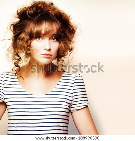 Cute whimsical woman with a tangled knotty blonde hairstyle with bangs and ringlets, hair style and hairdressing concept on copyspace background - stock photo