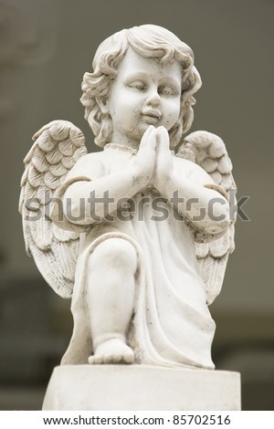 Cute winged Angel statue in praying pose