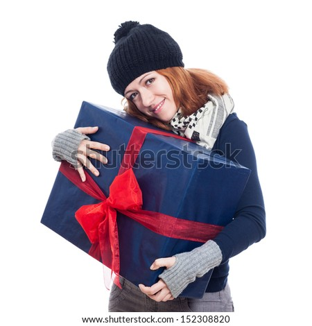 Cute winter woman holding big present, isolated on white background. - stock photo