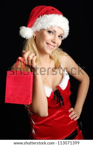 Cute woman dressed as Santa on a black background