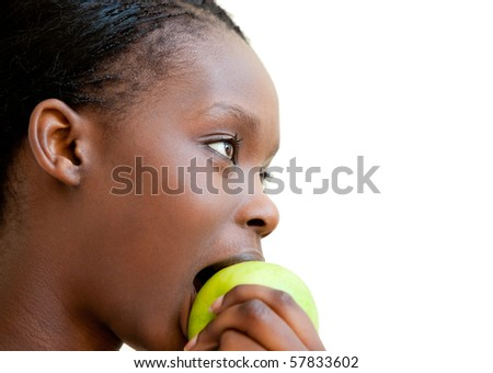 Cute woman eating apple against a white background - stock photo