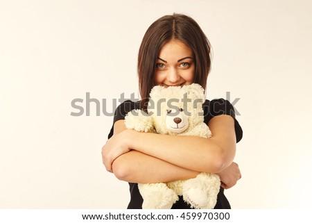 Cute woman holding a teddy bear - stock photo