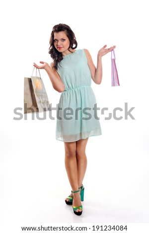 cute woman in blue dress with shopping bag on a white background