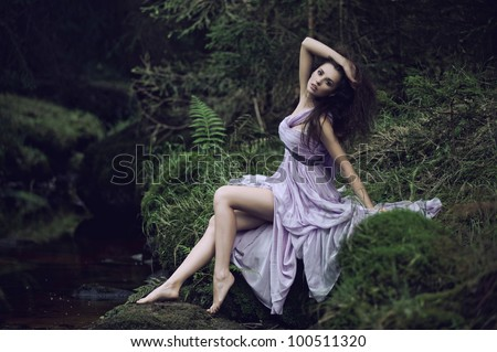 Cute woman in nature scenery - stock photo