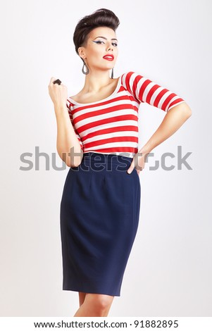cute woman in striped t-shirt - stock photo