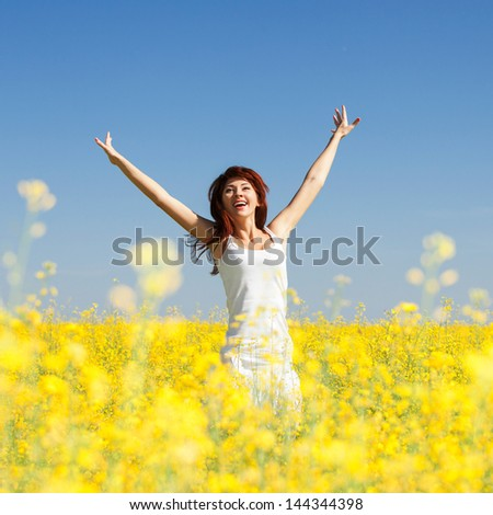 Cute woman in the field with flowers - stock photo