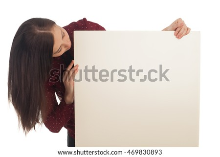 Cute woman is looking on a canvas