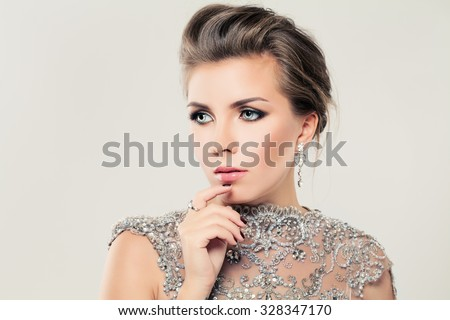 Cute Woman. Lace, Strass and Jewelry - stock photo