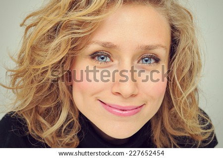 Cute Woman looking up into the camera with her intense eyes.  - stock photo