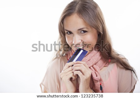 Cute woman loves shopping with her credit card - stock photo