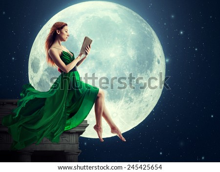 Cute woman over full moon background reading book. Elements of this image furnished by NASA - stock photo