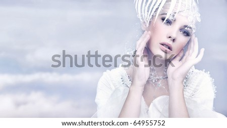 Cute woman over winter background - stock photo