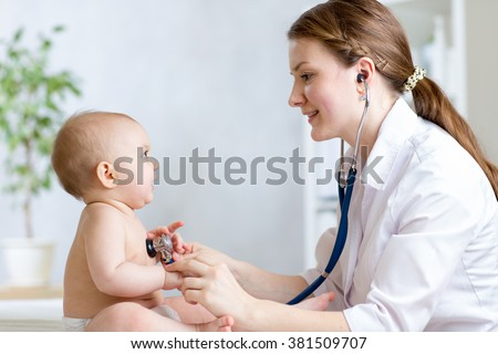 Cute woman pediatrician examining of baby kid with stethoscope