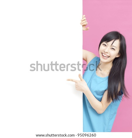 Cute woman pointing blank white board.