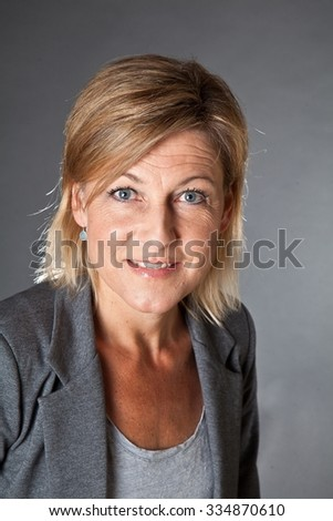Cute woman portrait with grey background
