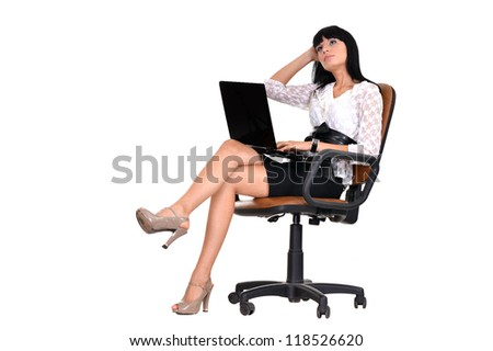 cute woman sitting on an office chair - stock photo