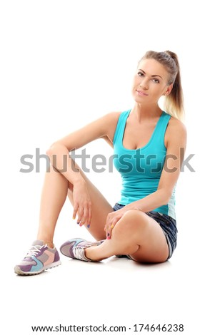 Cute woman sitting on the floor