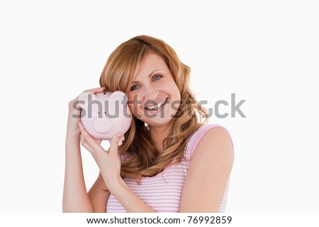 Cute woman smiling while holding her piggyback on a white background