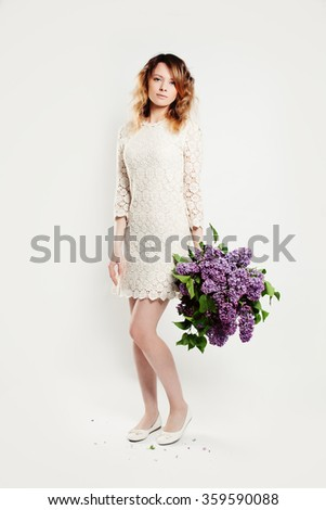 Cute Woman Standing with Big Bouquet of Spring Flowers - stock photo