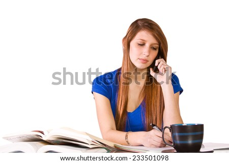 Cute Woman Studying at her Desk  - stock photo