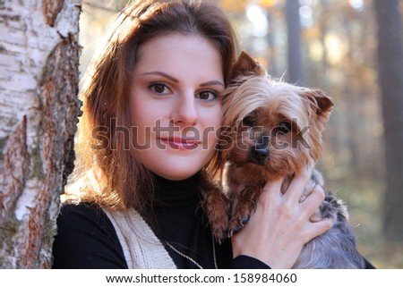 cute woman walking with yorkshire terrier