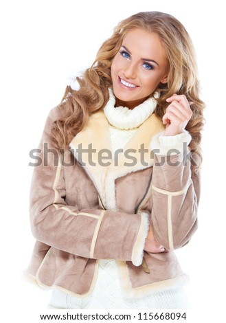 Cute woman wearing modern winter fur jacket , isolated