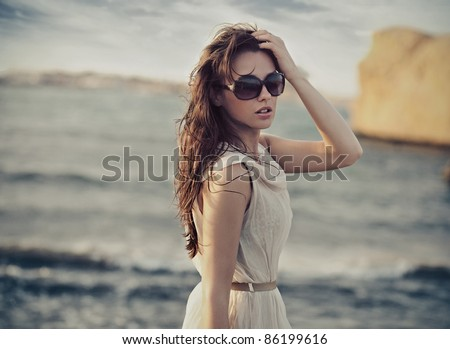 Cute woman wearing sunglasses - stock photo
