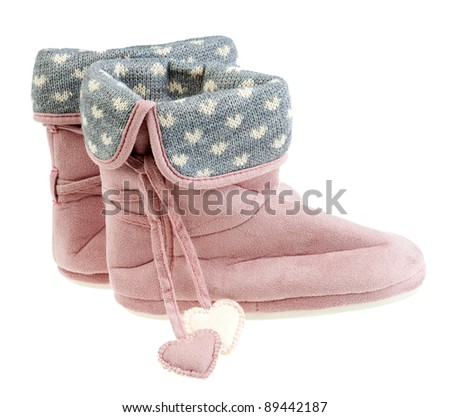 cute woman winter pink slippers with hearts - stock photo