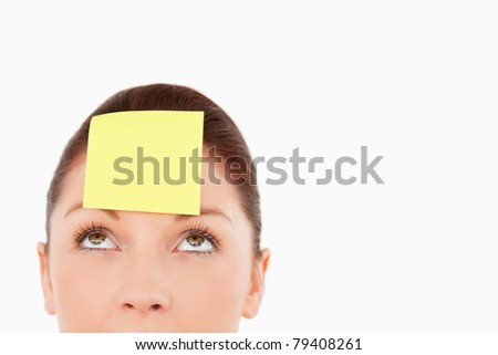 Cute woman with a sign on her forehead against a white background