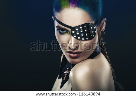 cute woman with coloured hair and eye-patch - stock photo